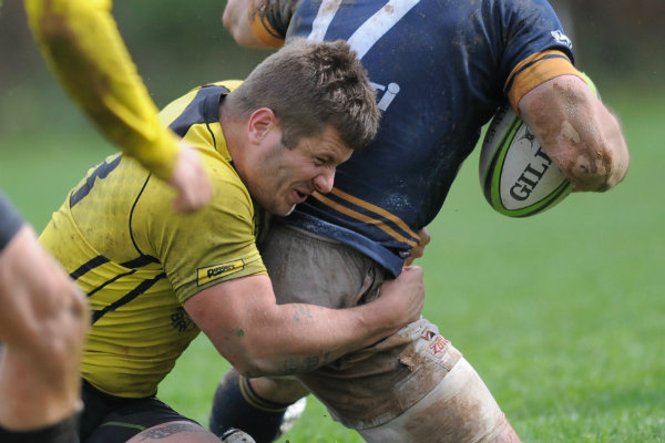 a player from the pittsburgh rugby football club makes a tackle during a game