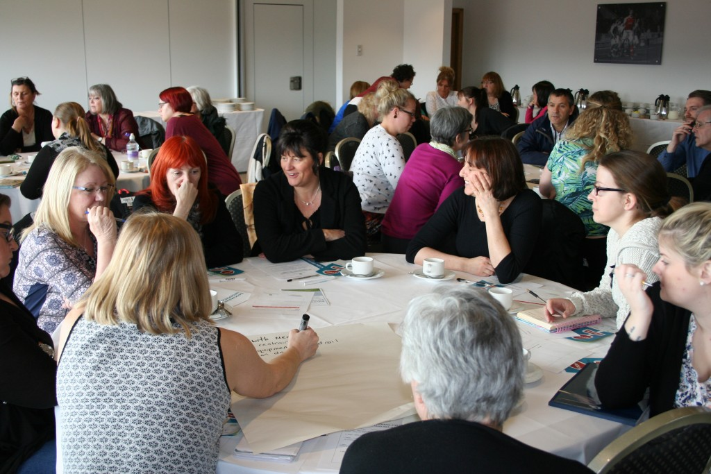 """An image of people in small groups, discussing issues around restraints, at the launch of the Let's Talk About Restraints"""" online training toolkit, which took place at Rotherham Football Stadium in March 2016."""