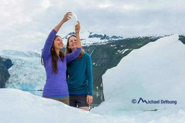 women-icebergs-glacier-alaska