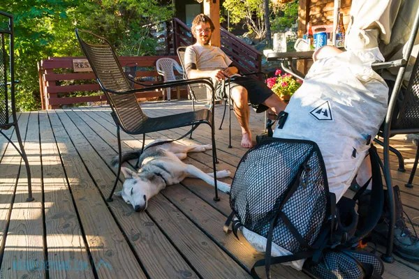 JS from Quebec and the very sweet and well behaved PCT dog, Luna, at the restaurant in Stehekin.