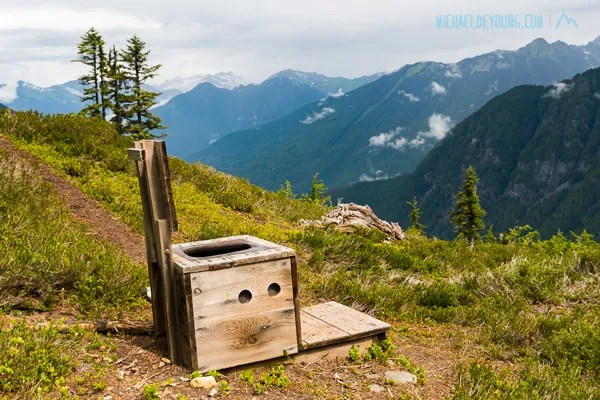Could be the best privy view in the U.S. at Mica Lake overlooking Milk River valley and the North Cascades, Glacier Peak Wilderness