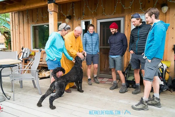 """Venerable Kozen with his dog Ven and fellow SOBO hikers Juliette, Thomas, Pierre, and Leo on the porch of Trout Lake Abbey with """"Trail Angel"""" Lauri"""