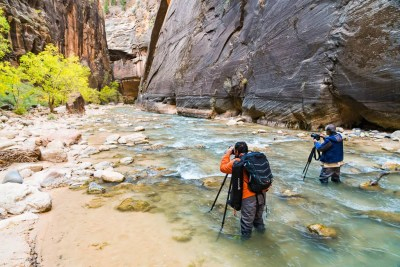 Photographers in the Virgin River Narrows in Zion National Park. © Michael DeYoung