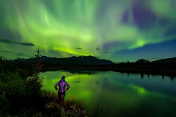 Image of woman watching aurora display
