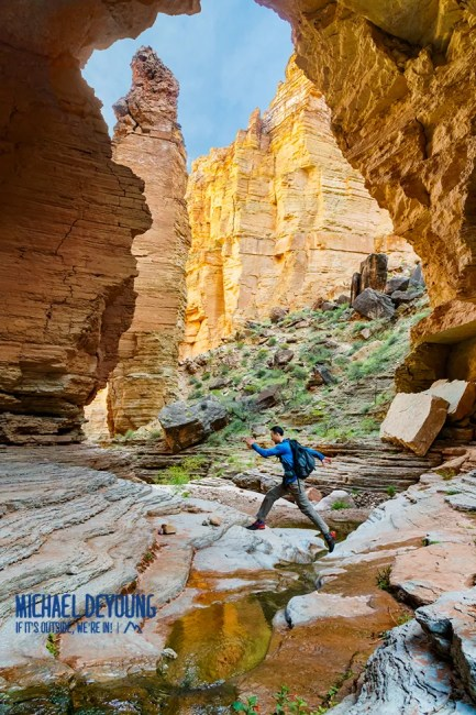 Hiker under the Royal Arch - the largest arch in Grand Canyon National Park
