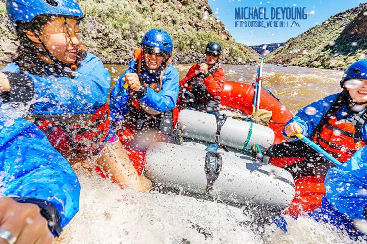 Close up of participants in a white water rafting trip in the Taos Box.