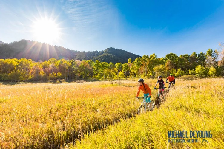 Family mountain biking near Snowbasin, Utah.