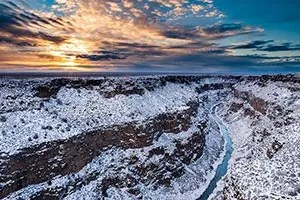Picture of Rio Grande with snow covered canyon walls