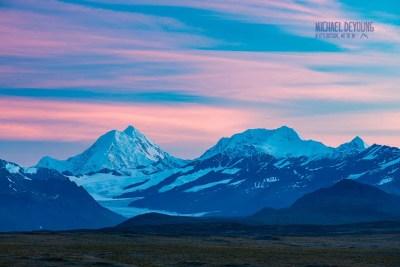 Pink skies over the high peaks in the Eastern Alaska Range. © Michael DeYoung