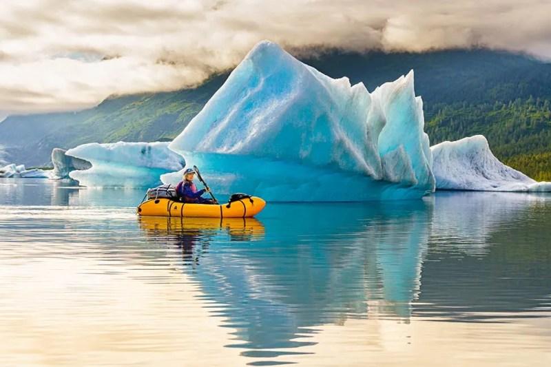 Pack rafting around ice bergs in Spencer Lake, Alaska. Photo © Michael DeYoung