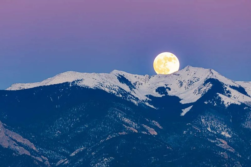 Full moon rising over Sangre de Cristo mountains east of the town of Taos, New Mexico. ©Michael DeYoung