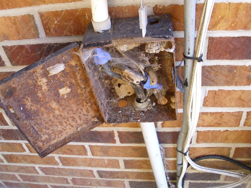 Rusted HVAC Panel with Open Knockout