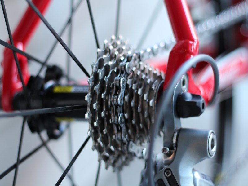 [photo of a bicycle wheel and gears]