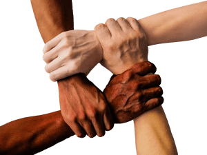 hands of many races holding wrists to make a tight group