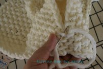 sewing knitted parts together