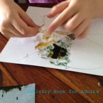 tearing and glueing magazine pieces