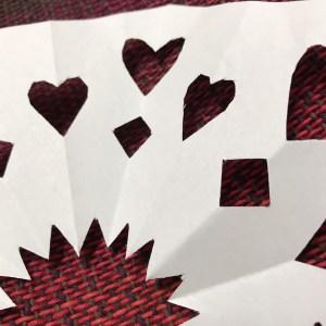 Handcut snowflake on woven fabric