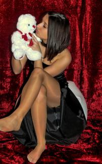 Unidentified young lady wearing pantyhose smooches her bear