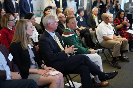 Rick Graber, Bradley Foundation CEO, seated with guests