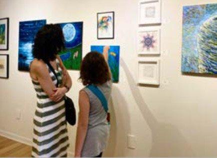 Visitors of the exhibit, UNSPOKEN: survivor storie