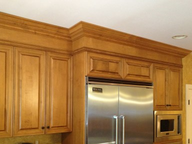 Cabinets around frig
