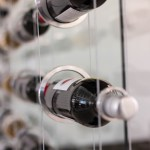 Close-up of Suspended Wine Rack Rings with Wine