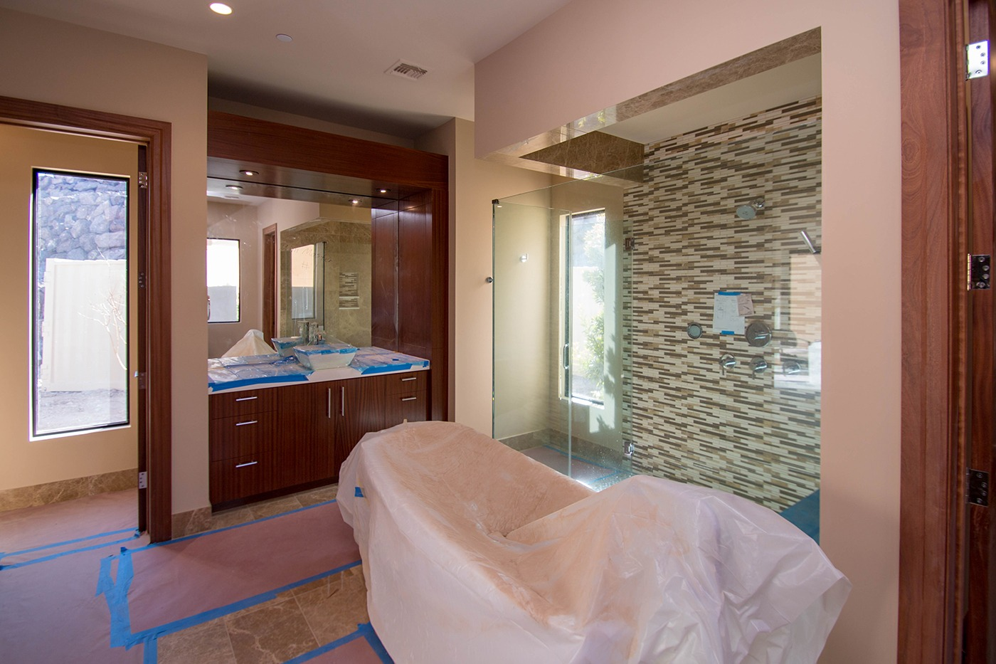 A beautiful custom glass shower door mirror system ascaya a beautiful custom glass shower door mirror system ascaya residential home in henderson nevada planetlyrics Choice Image