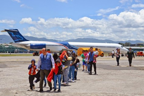 Photo credit: Foreign Ministry of Guatemala  Caption: Children deplane a Justice Prisoner and Alien Transportation System (JPATS) flight at the Guatemalan Air Force Base. From January to June of 2014, an estimated 1500 unaccompanied children have been deported from the United States to Central America. Site: http://www.speroforum.com/a/LPMGKNPJRX59/75048-Guatemala-receives-second-group-of-children-deported-by-US#.VBJk1vldX0Q