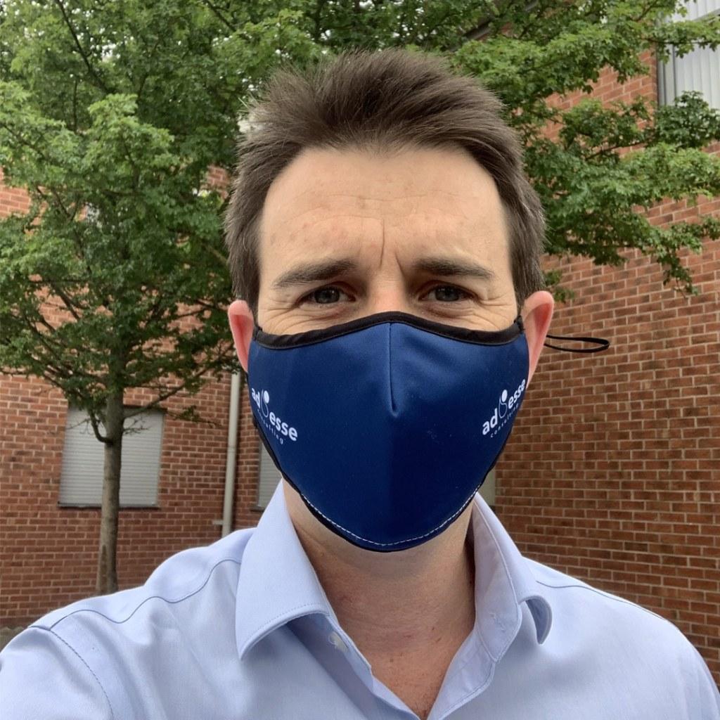 Ad Esse Consulting mask selfie by Adam Davies, Consultant