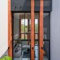 Townhouses with Private Courtyards / baan puripuri © Beer Singnoi