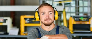 Young Male at Work - Protective Headphones