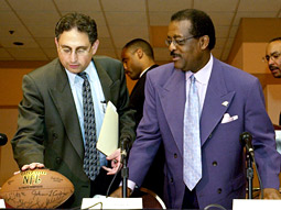 Cyrus Mehri (l.) makes things happen even when there's no lawsuit involved, as he did when he and Johnnie Cochran released a report on the lack of black coaches in the NFL, which led to numerous hires.