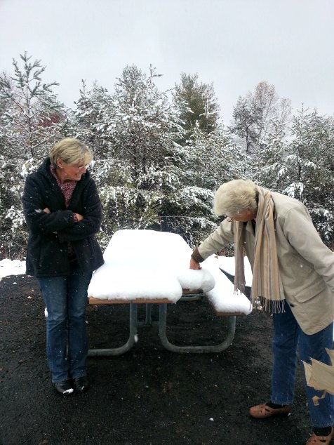 MawMaw and Mimi Measuring Snow. Asheville, NC. Blueridge Parkway Visitors Center. November 2014