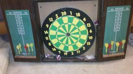 House project #3: the dart board that needs to be hung. Anyone...?
