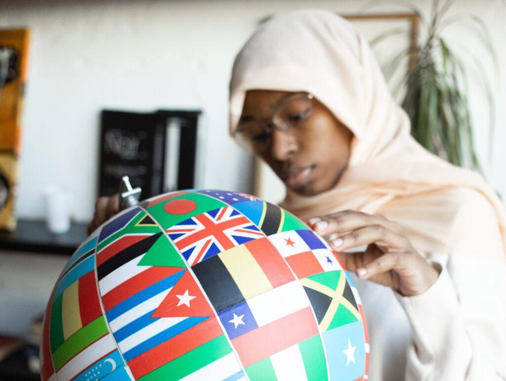 Muslim looking at flags