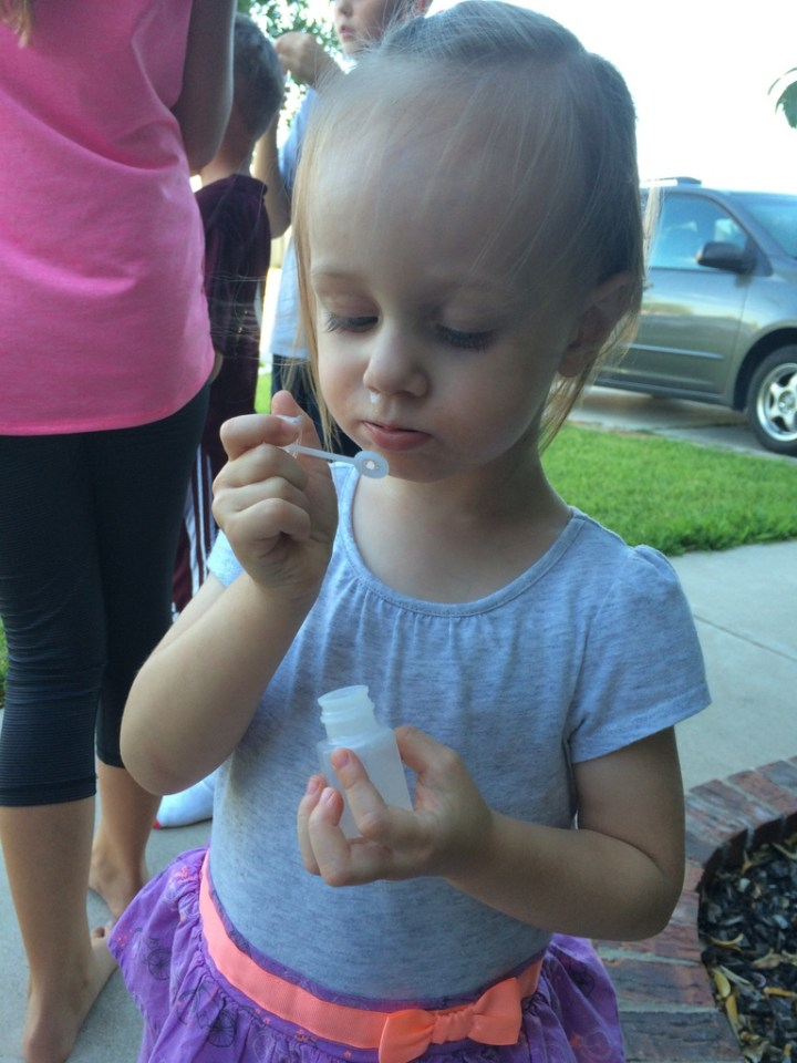 Eliza loved the bubbles at her friend's birthday party.