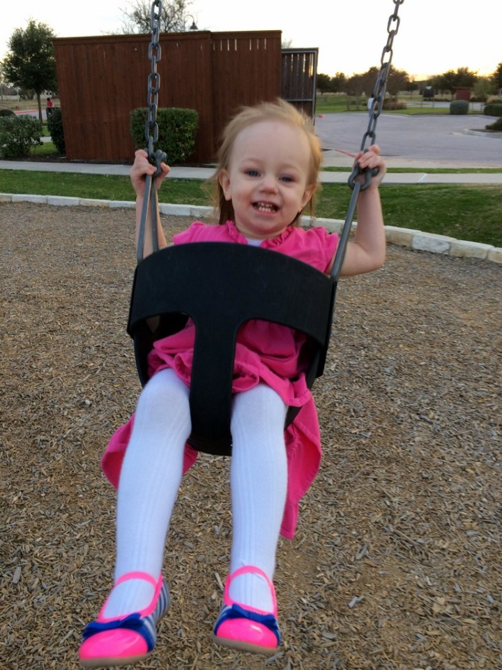 She loves swinging.