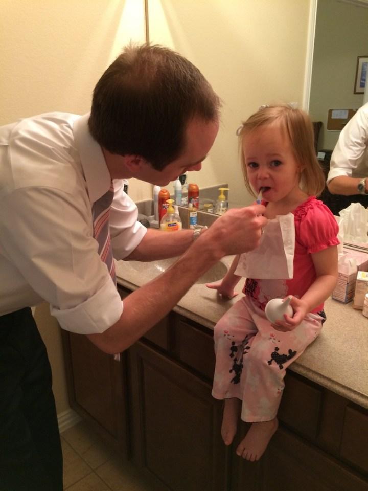 Eliza brushing her teeth