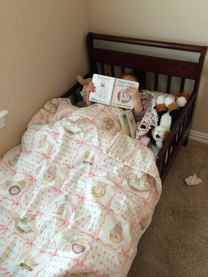 Eliza love books and has started to read to herself while in bed.