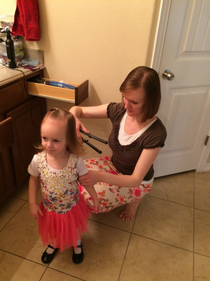 On Sundays, Eliza will often ask for mommy to curl her hair.