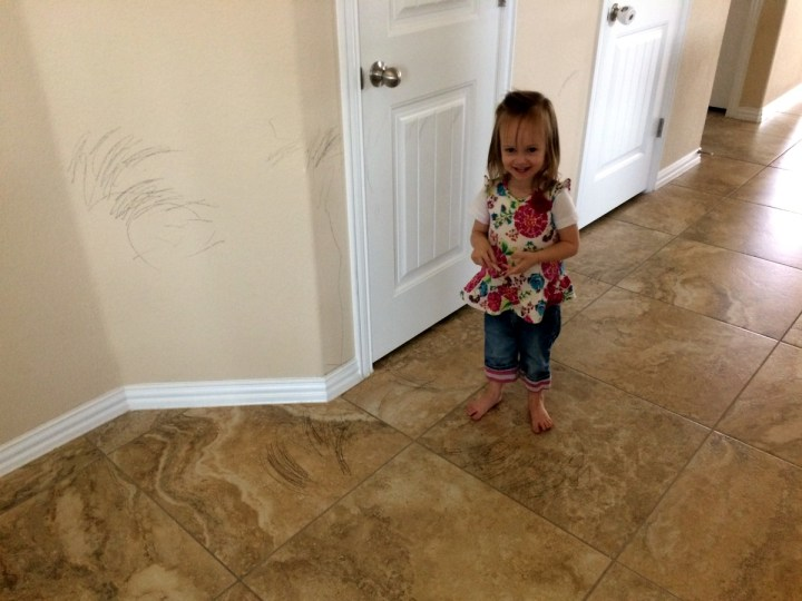 We had an initiation of sorts this week when Eliza redecorated the wall with her black crayon.