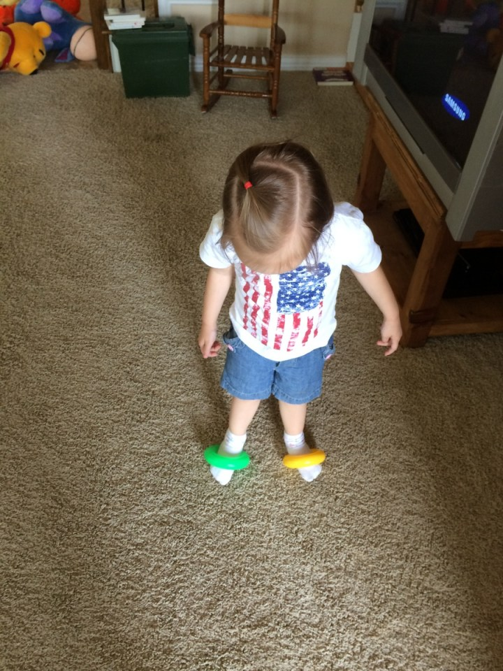 Eliza pretended that these rings were her shoes. She wore them for several hours.
