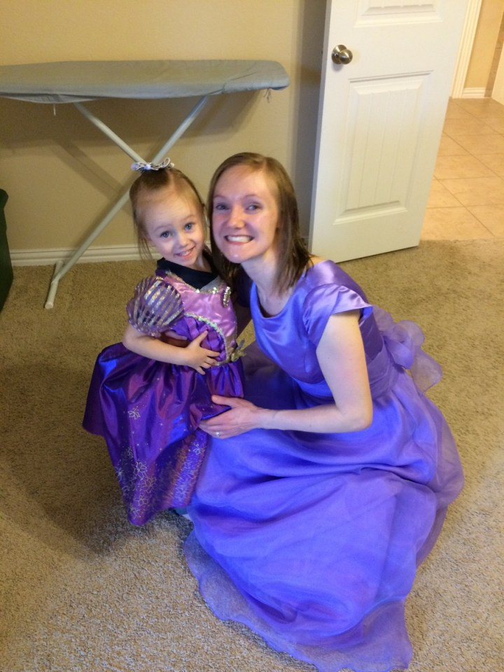 Sarah showed Eliza her formal dress and Eliza had to put on her purple dress to match.