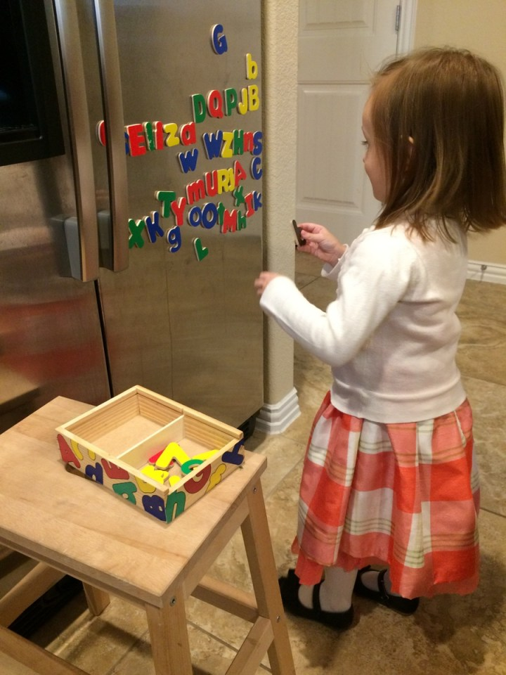 She has started learning her letters and we finally remembered her magnetic letters from last Christmas.