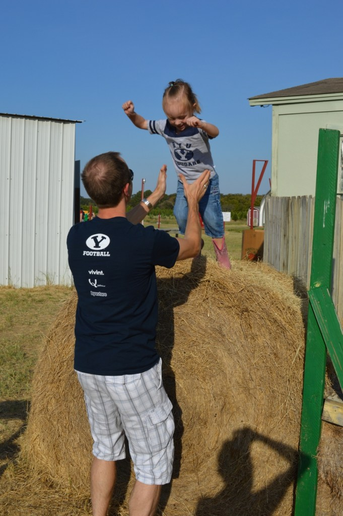 Eliza jumping to daddy.
