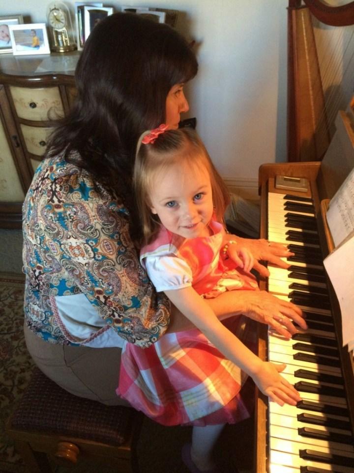 Eliza loved playing the piano with Grandma Huggard
