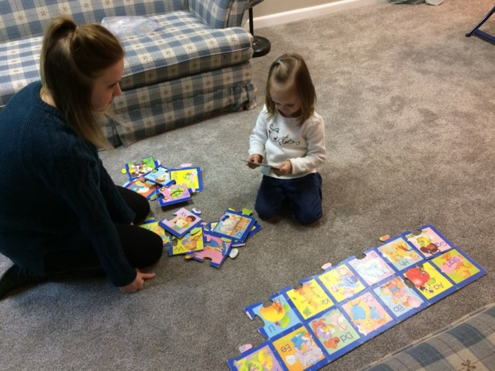 Aunt Beka helped Eliza put together an old alphabet puzzle.