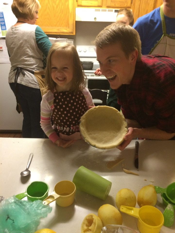 At the annual pie making party Uncle Spencer helped Eliza make a pecan pie.