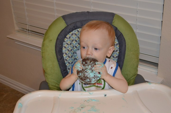 James eating his cake one-year-old style.