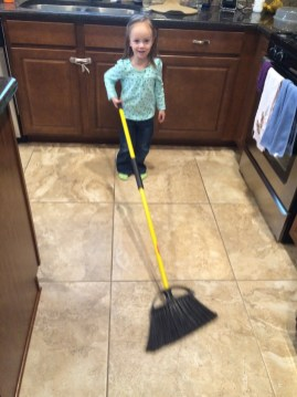 Eliza helping daddy sweep the floor.